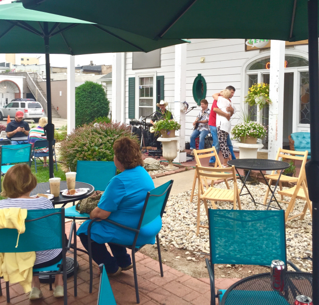"""Jim Sieg and his """"One Man Band,"""" playing gaily out in front of the Geneva Java Coffee Shop on 252 Center Street. If you like gentle, easy-going, pretty quiet country and rock music then this is your place on Saturday nights. He's there again on Saturday from five to nine in the evening."""
